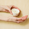 Burn & Bliss Soy Wax Massage Oil Candle - Peppermint & Eucalyptus in hand