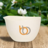 Burn & Bliss Soy Wax Massage Oil Candle - Peppermint & Eucalyptus outdoors