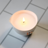 Burn & Bliss Soy Wax Massage Oil Candle - Soothing Lotus on tiles